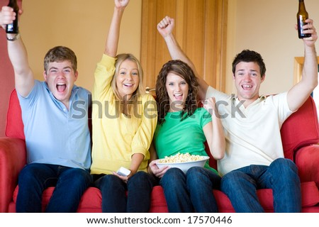 Four young adults having fun at home