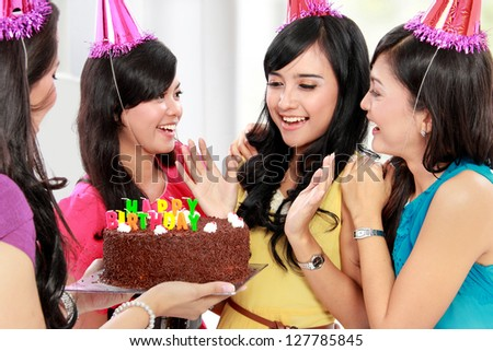 four young beautiful woman happy celebrate birthday