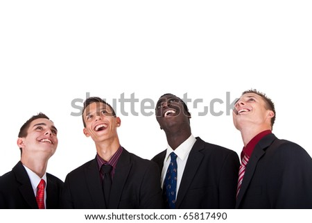 Four young businessmen looking up. Isolated over pure white background.