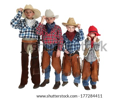 four young cowboys having fun posing silly - stock photo