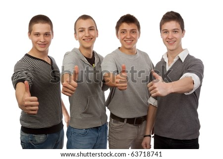 Four young friends gesturing ok - stock photo