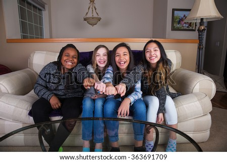 Four young girls with cultural diversity making a unified fist f - stock photo