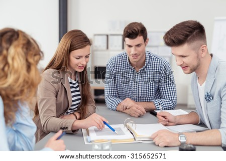 Four Young Office People Discussing the Business Document Inside the Boardroom in the Office