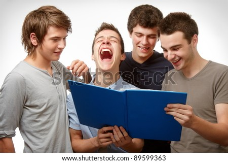 Four young people working and having fun together - stock photo
