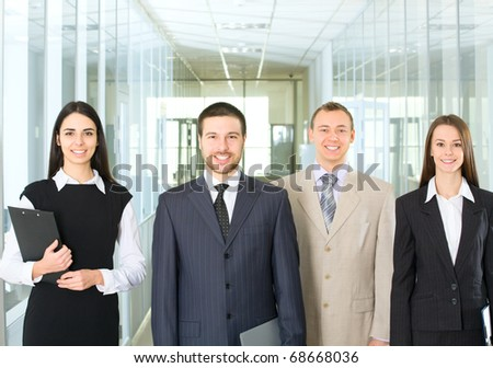 Four young professionals looking at camera - stock photo