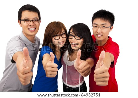 Four young student laughing and giving the thumbs-up - stock photo