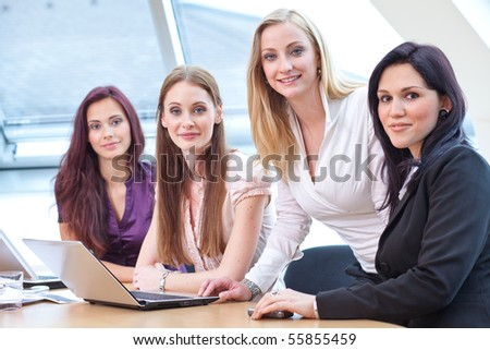 four young women in business look helping each other - stock photo