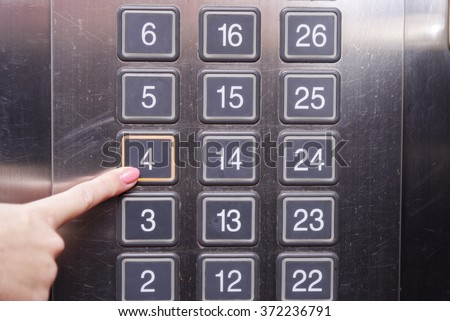 Fourth (4th) Floor Elevator Button Is Pushed By A Female Finger