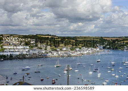 Fowey and cove from Polruan , Cornwall, view of cove harbor and village on southern coast of Cornwall, shot from the opposite side of the cove  - stock photo