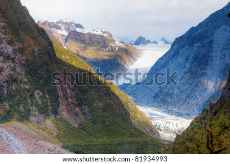Fox Glacier in the mountains of New Zealand - stock photo