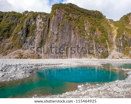 Fox Glacier in Westland National Park on the West Coast of New Zealand's South Island - glacial landscape with temperate rainforest - stock photo