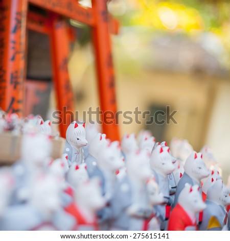 Fox statues at Fushimi Inari Shrine in Kyoto, Japan - stock photo