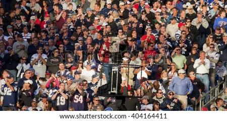 FOXBOROUGH, BOSTON MASS - OCTOBER 16, 2011: Blurred Crowd shot at Gillette Stadium, the NFL Super Bowl Champs New England Patriots play the Dallas Cowboys - stock photo