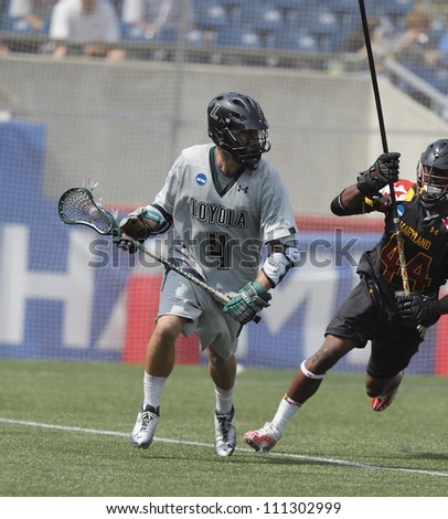FOXBOROUGH - 28 MAY: Mike Sawyer (4), Loyola University, Maryland, brings the ball to the goal at the NCAA Men's Division 1 Lacrosse Championship game in Foxborough, Massachusetts, 28 May 2012