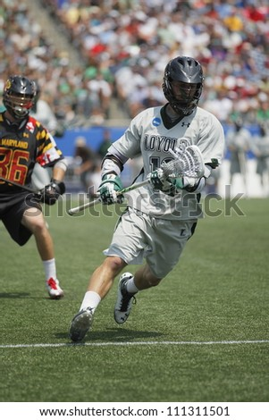 FOXBOROUGH - 28 MAY: Nikko Pontrello (18), Loyola University Maryland, brings the ball down the field at the NCAA Men's Division 1 Lacrosse Championship game, 28 May 2012 in Foxborough, Massachusetts