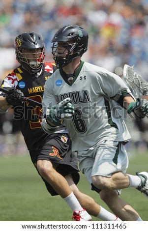 FOXBOROUGH - 28 MAY: Pat Byrnes (6), Loyola University Maryland, brings the ball around the goal at the NCAA Men's Division 1 Lacrosse Championship game, 28 May 2012. in Foxborough, Massachusetts
