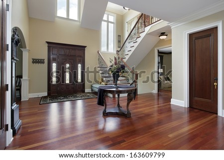 Foyer in luxury home with cherry wood flooring - stock photo