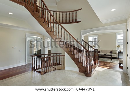 Foyer in luxury home with curved staircase - stock photo