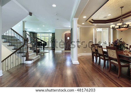 Foyer in luxury home with dining room view - stock photo