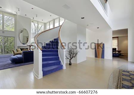 Foyer in modern home with purple carpeted stairs - stock photo