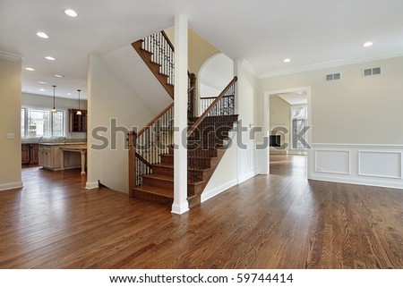 Foyer in new construction home with stairway - stock photo