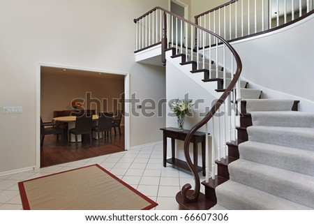 Foyer in suburban home with curved staircase - stock photo