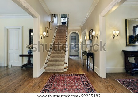 Foyer in suburban home with dining and living room entry - stock photo