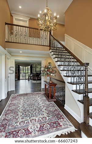 Foyer in suburban home with gold walls - stock photo