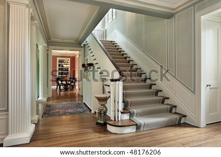 Foyer in traditional home with green walls - stock photo