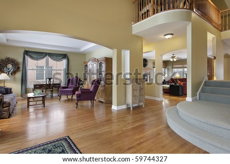 Foyer in upscale home with living room view - stock photo