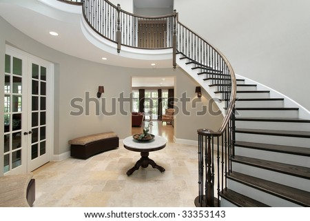 Foyer with circular staircase - stock photo