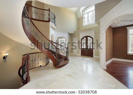 Foyer with curved staircase - stock photo
