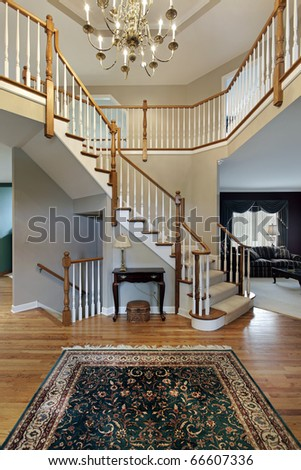 Foyer with wood trim railing on stairway - stock photo