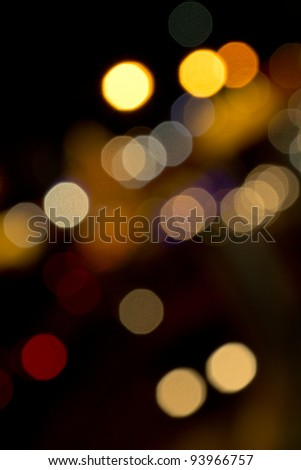 Fractured pin points of warm light forming bokeh. - stock photo