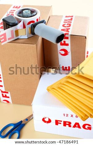 Fragile delivery service. Box, scotch tape, envelops - stock photo