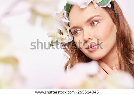 Fragile girl with natural makeup looking sideway - stock photo