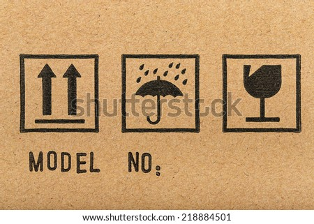 Fragile Keep Dry (with Up Arrows, Umbrella, Broken Glass Symbol) - stock photo