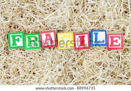 Fragile Spelled Out in Blocks in Packing Material - stock photo