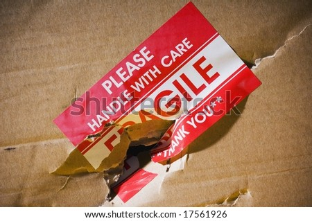 Fragile sticker on shipping box - stock photo