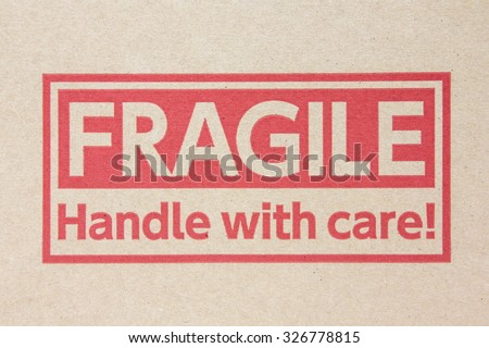 Fragile symbol on brown paper box