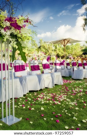 fragment like view of nice chairs ready for wedding ceremony - stock photo