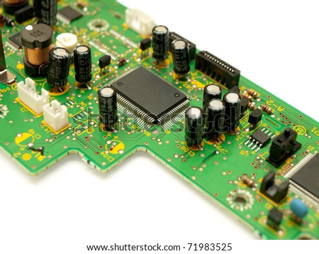 Fragment of a circuit board. Focus on microchip. - stock photo