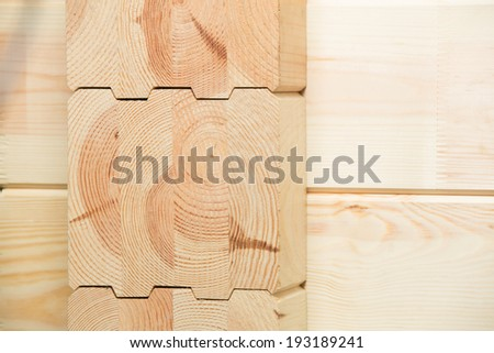 Fragment of a construction built of glued pine timber   - stock photo