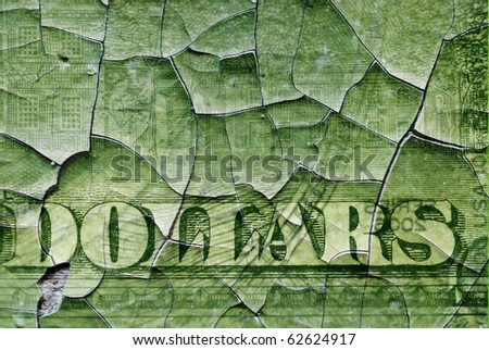 Fragment of a dollar banknote covered with cracks - stock photo