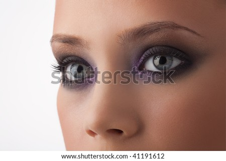 Fragment of a fine woman's face in a fashionable make-up - stock photo