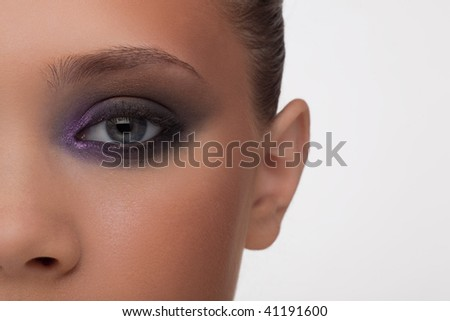 Fragment of a fine woman's face in a fashionable make-up professionally done. - stock photo