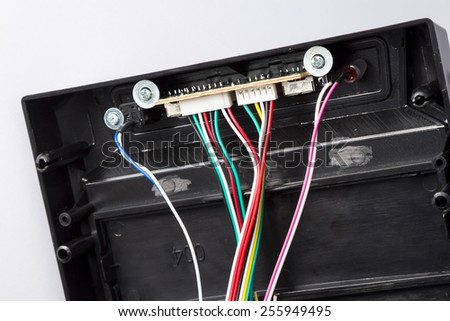 Fragment of a front panel of the computer casing.Back part of a front panel with ports of connection of additional devices. Black computer casing. - stock photo