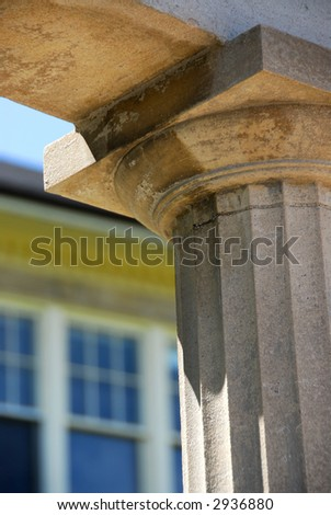 Fragment of a high school building with a column - stock photo