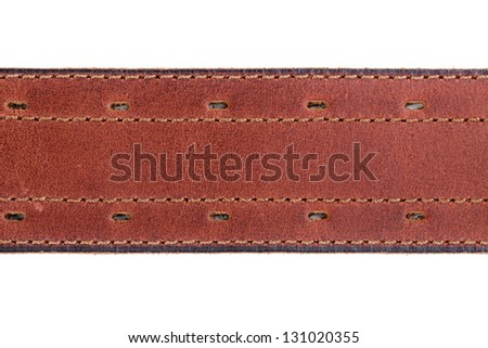 Fragment of a leather belt close-up on white background