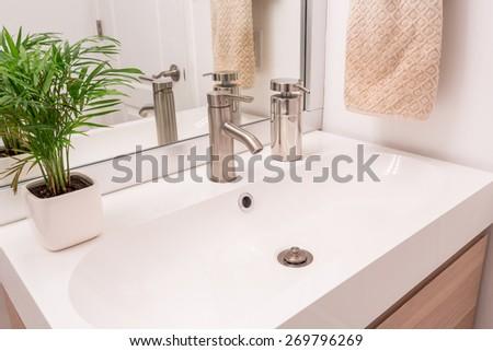 Fragment of a luxury bathroom, sink - stock photo